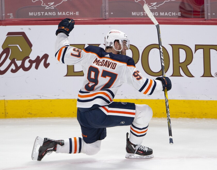 Edmonton Oilers' Connor McDavid (97) celebrates after scoring the winning goal during overtime of an NHL hockey game in Montreal, Monday, May 10, 2021. (Ryan Remiorz/The Canadian Press via AP)