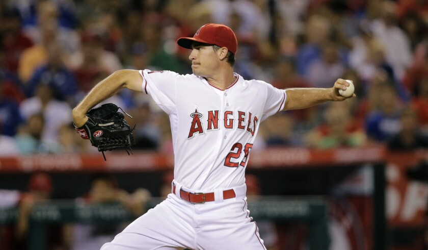 Los Angeles Angels starting pitcher Andrew Heaney throws against the Los Angeles Dodgers during the third inning on Tuesday.