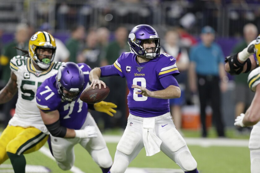 """FILE - In this Monday, Dec. 23, 2019 file photo, Minnesota Vikings quarterback Kirk Cousins throws a pass during the second half of an NFL football game against the Green Bay Packers in Minneapolis. Minnesota Vikings quarterback Kirk Cousins says he's unconcerned about catching the coronavirus. He says his worry on a scale of one to 10 is """"about a 0.000001."""" Cousins made his comments on a wide-ranging interview for an NFL-themed podcast that was released on Wednesday, Sept. 2, 2020. (AP Photo/Andy Clayton-King, File)"""