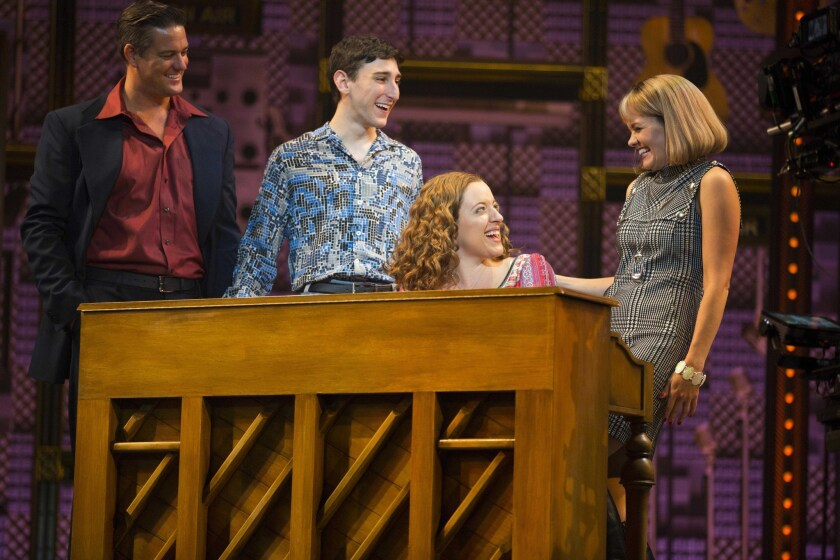 Carole King (Abby Mueller) is at the piano with, from left, music publisher and producer Don Kirshner (Curt Bouril) and songwriters Barry Mann (Ben Fankhauser) and Cynthia Weil (Becky Gulsvig).