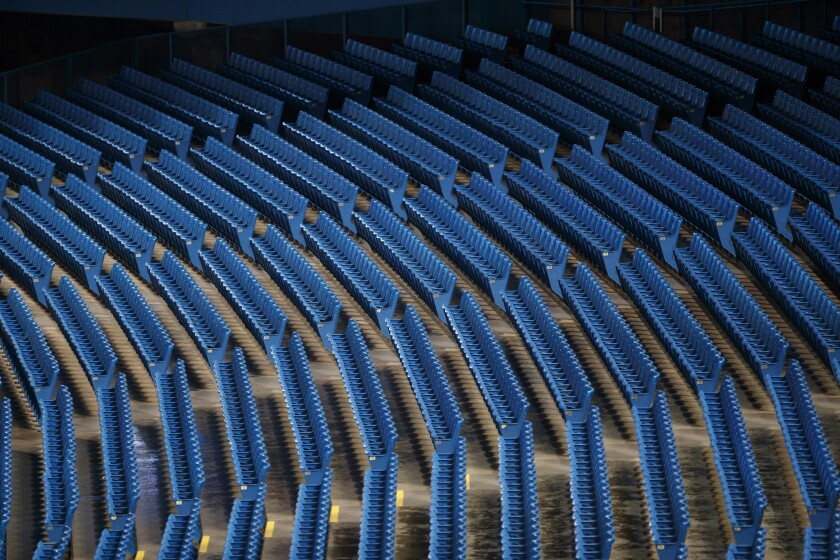 Empty seats are viewed inside Rogers Centre during batting practice at baseball summer training in Toronto, Sunday, July 19, 2020. (Cole Burston/The Canadian Press via AP)