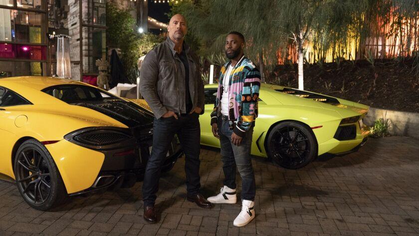 Dwayne Johnson and John David Washington as Ricky Jerret. From the HBO series Ballers. (HBO/ Jeff Da