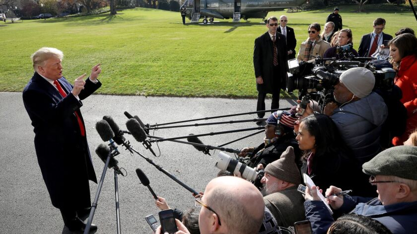 President Trump speaks to reporters outside the White House shortly after Michael Cohen pleaded guilty on Thursday.