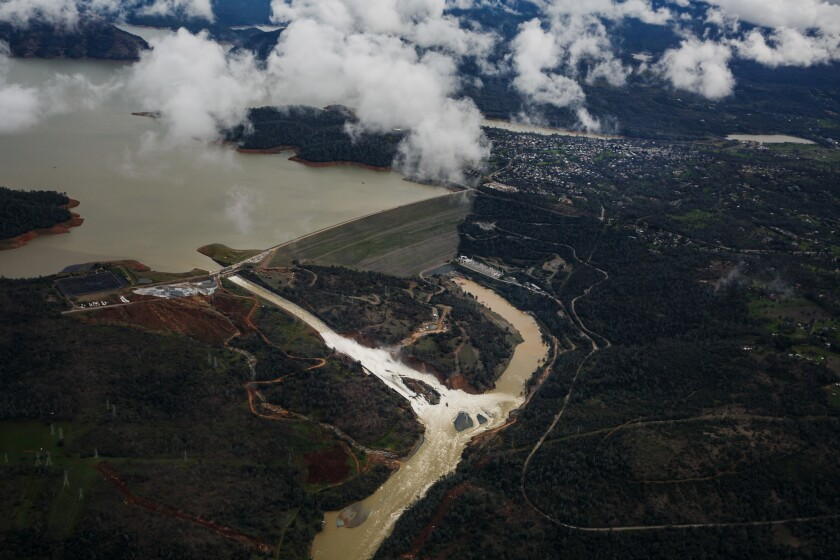 An aerial view of the water flowing out of the Oroville Dam main spillway, in Oroville, Calif., on Tuesday, February 21, 2017.