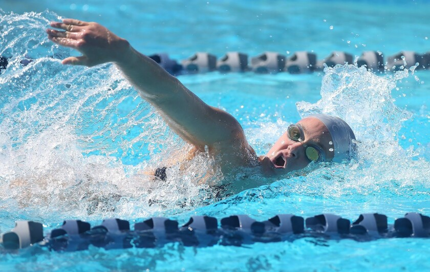 Newport Harbor's Ayla Spitz wins the girls' 200 yard free during Surf League swim meet against Los A