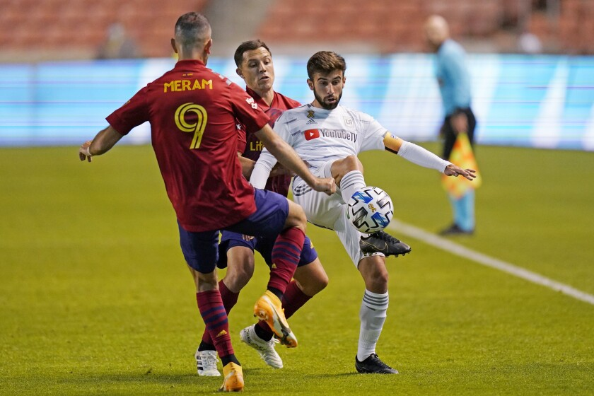 Diego Rossi battles for the ball with Real Salt Lake's Justin Meram and Donny Toia.