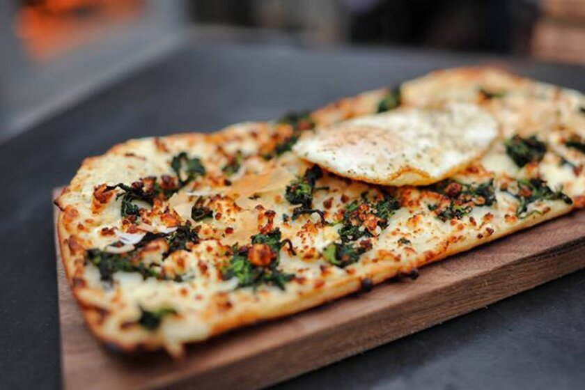 Diners will find upscale flatbreads and much more at 100 Wines.
