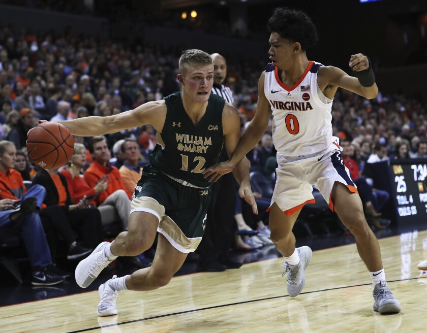 File-This Dec. 22, 2018, file photo shows William & Mary's guard Luke Loewe (12) driving around Virginia guard Kihei Clark (0) in the first half of an NCAA college basketball game, in Charlottesville, Va. Minnesota has made Loewe the latest piece of a major offseason roster revamp, picking up the graduate transfer from William & Mary. The Gophers announced the addition of Loewe on Monday, May 3, 2021. The 6-foot-4, 186-pound Loewe was a two-time All-Defensive Team pick in the Colonial Athletic Association and a second-team All-CAA selection in 2020-21. (AP Photo/Zack Wajsgras, File)