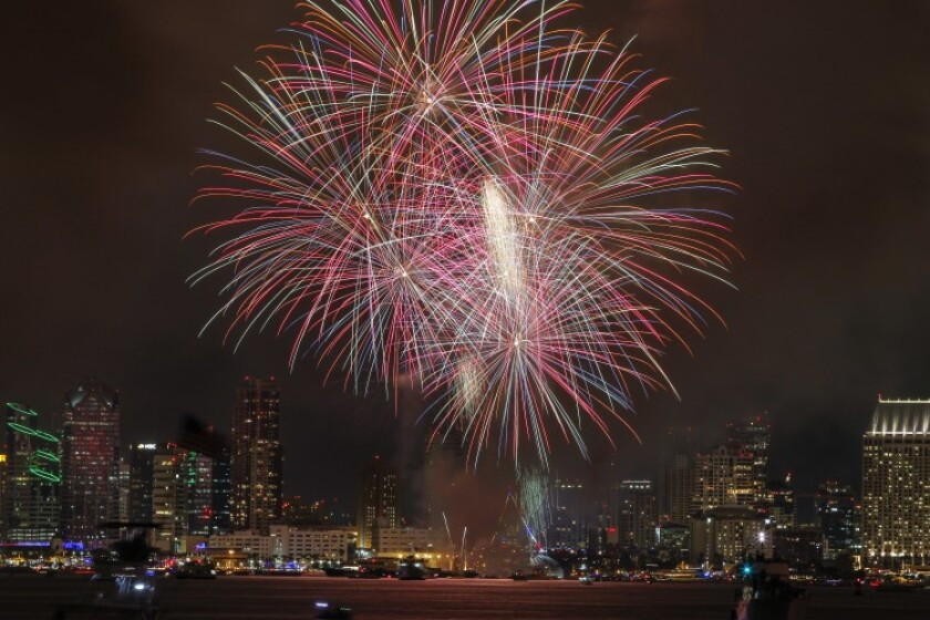 Fireworks explode above the San Diego