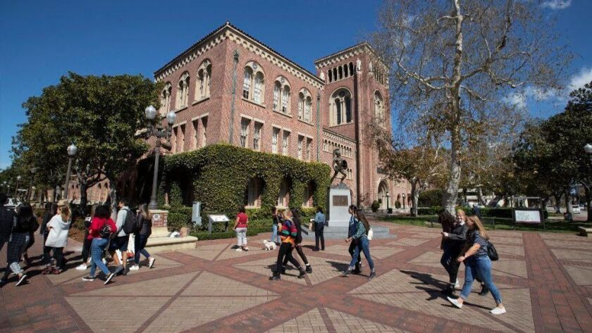 Students walk between classes at the USC campus.