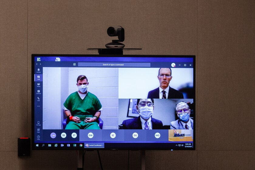 Photo of TV monitor during video arraignment