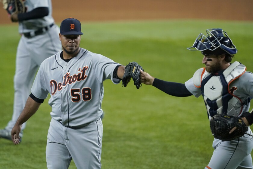 Detroit Tigers' Wily Peralta (58) and catcher Eric Haase greet each other after working against the Texas Rangers in the fifth inning of a baseball game in Arlington, Texas, Monday, July 5, 2021. (AP Photo/Tony Gutierrez)