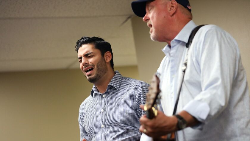 ESCONDIDO-CA-SEPTEMBER 9, 2018: Ammar Campa-Najjar, left, sings with his former philosophy professor