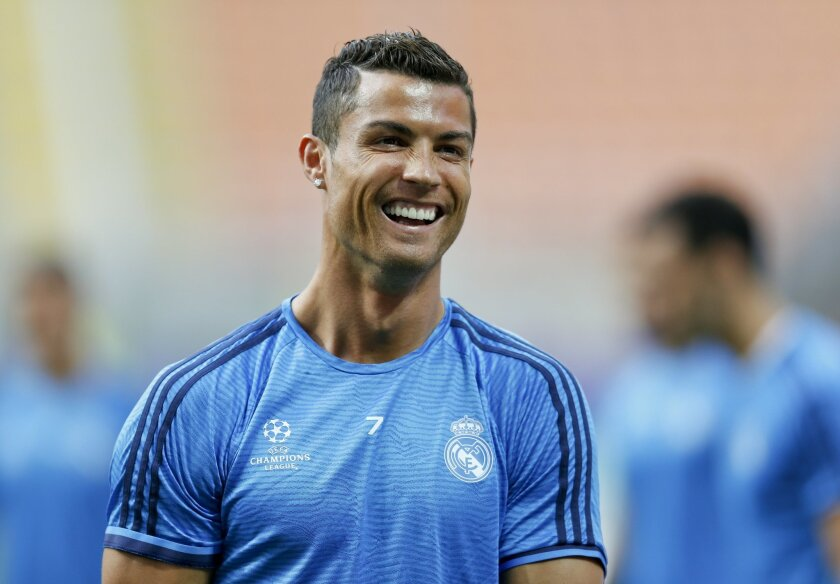 Real Madrid's Cristiano Ronaldo smiles during a training session at the San Siro stadium in Milan, Italy, Friday, May 27, 2016. The Champions League final soccer match between Real Madrid and Atletico Madrid will be held at the San Siro stadium on Saturday, May 28. (AP Photo/Manu Fernandez)