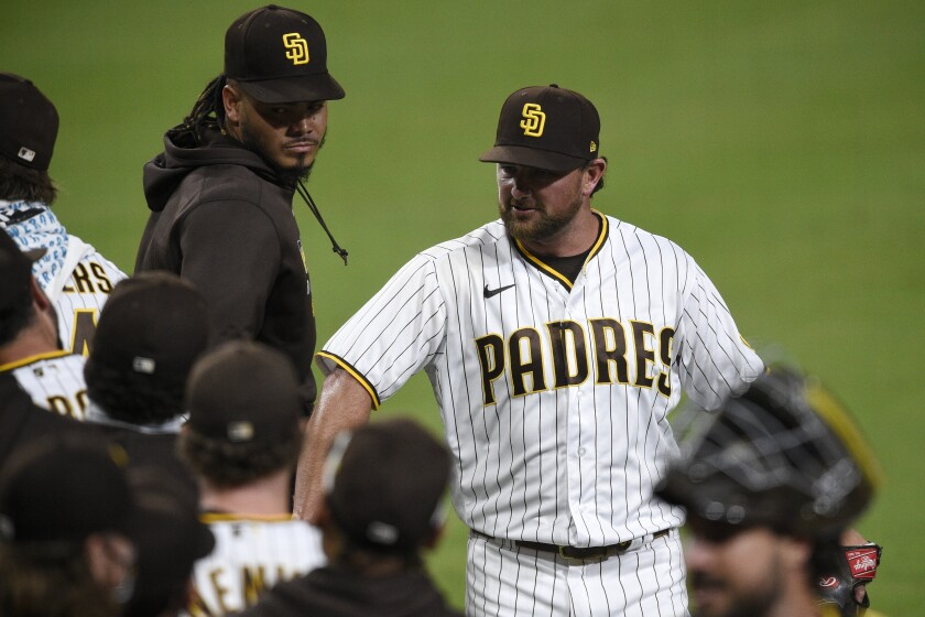 Kirby Yates (right) celebrates after finishing July game for Padres.
