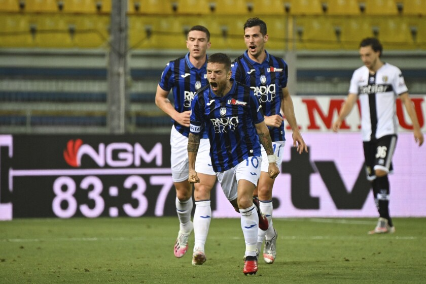 Atalanta's Alejandro Gomez, center, celebrates after he scored his side's first goal during a Seria A soccer match between Parma and Atalanta, at the Ennio Tardini stadium, in Parma, Italy, Tuesday, July 28, 2020 . (Massimo Paolone/LaPresse via AP)