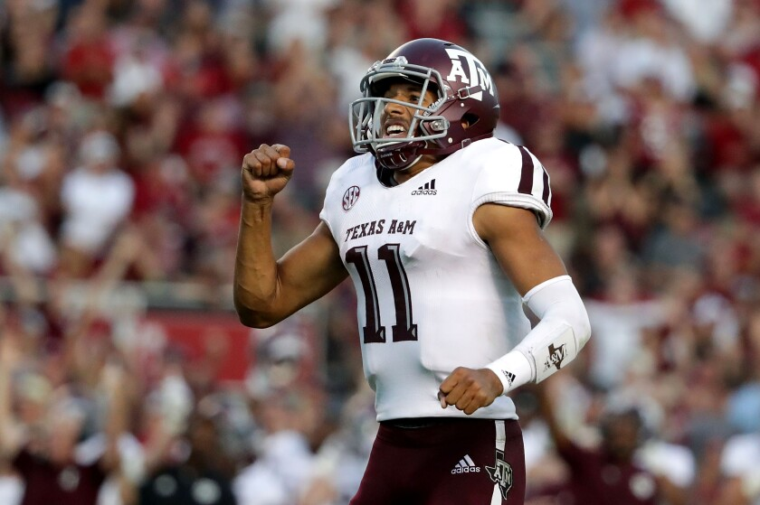 Texas A&M quarterback Kellen Mond celebrates a touchdown Oct. 13, 2018.
