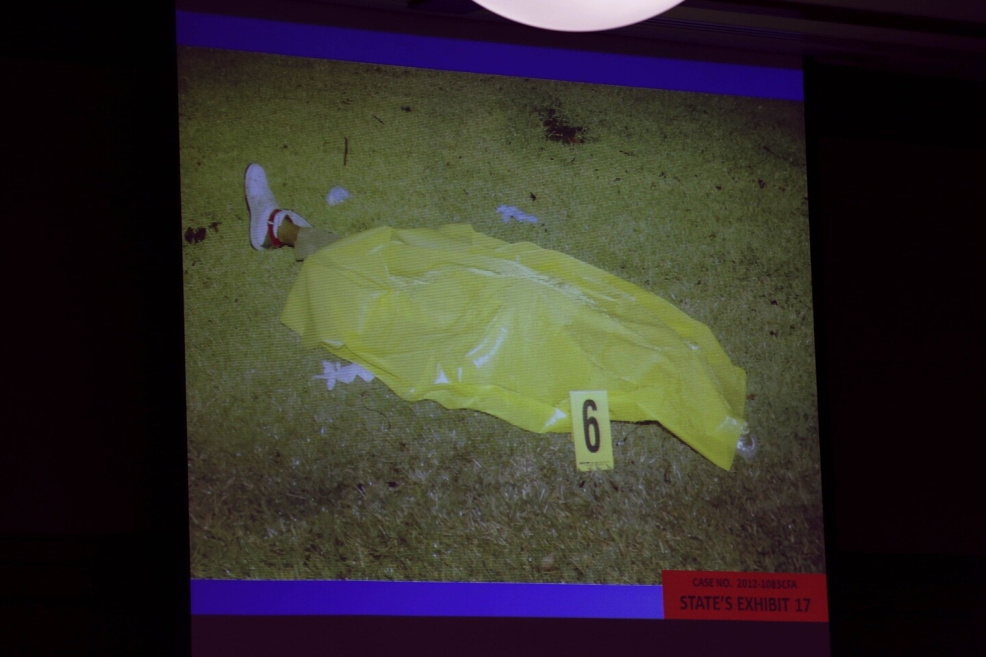 This photo, which shows Trayvon Martin's body covered with a plastic tarp on the night he was shot, was entered into evidence by the State of Florida during George Zimmerman's trial.