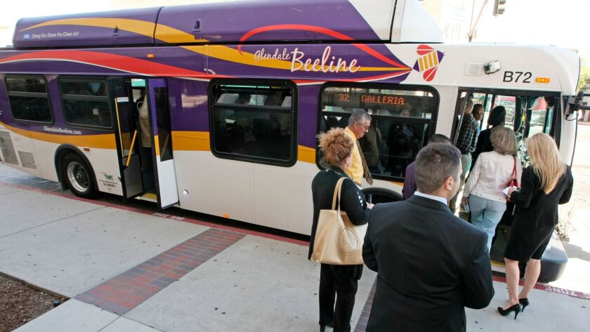 Workboot meeting participants board a Beeline bus at Broadway and Glendale Ave. on Tuesday, March 2