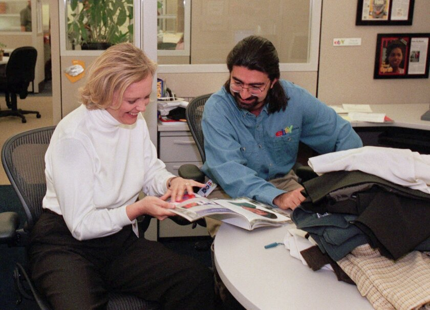 File - In this May 21, 1999 file photo, eBay chief executive officer Meg Whitman, left, and Pierre Omidyar, eBay's chairman of the board, leaf through a magazine at the company's headquarters in San Jose, Calif. The courtroom fight between former pro wrestler Hulk Hogan and news-and-gossip site Gaw