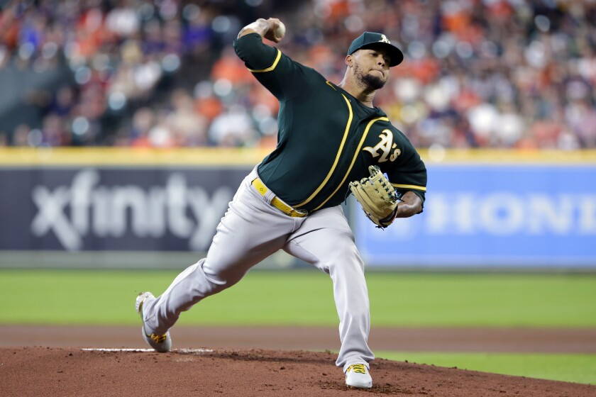 Oakland Athletics starting pitcher Frankie Montas throws against the Houston Astros during the first inning of a baseball game Thursday, July 8, 2021, in Houston. (AP Photo/Michael Wyke)