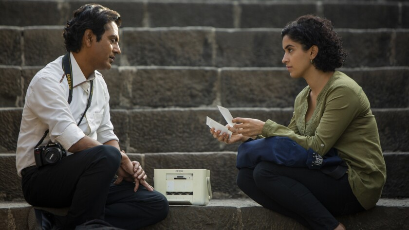 "Nawazuddin Siddiqui and Sanya Malhotra in ""Photograph."""