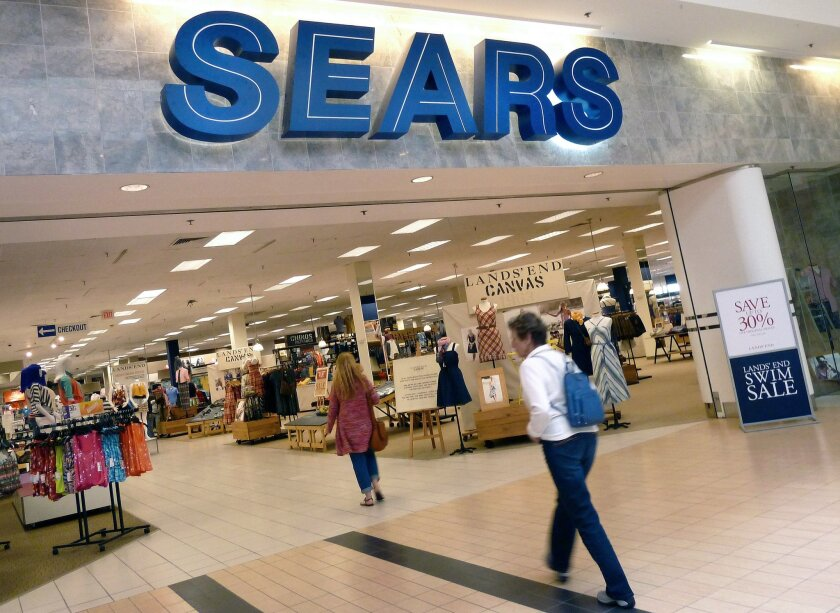 """FILE - In this May 14, 2012 file photo, shoppers walk into Sears in Peabody, Mass. After a """"challenging"""" holiday shopping season, Sears is accelerating the closing of some of its stores. Shares fell nearly 3 percent in Tuesday, Feb. 9, 2016 premarket trading. (AP Photo/Elise Amendola)"""