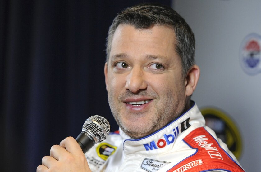 FILE - In this Jan. 21, 2016, file photo, Stewart Haas co-owner and driver Tony Stewart talks to members of the media during the NASCAR Charlotte Motor Speedway Media Tour in Charlotte, N.C. With four-time champion Jeff Gordon retired and three-time champ Tony Stewart sidelined with a broken back,