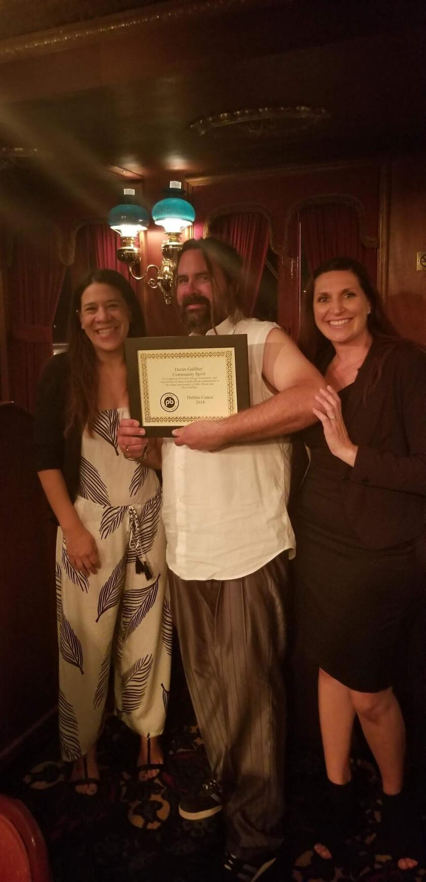 The Duran-Galliher Community Spirit Award (in recognition of tireless energy, enthusiasm and contributions to many neighborhood organizations in memory of Mike Duran and Rose Galliher) went to Debbie Conca of Mr Frostie, accepted by her son Jack Conca.