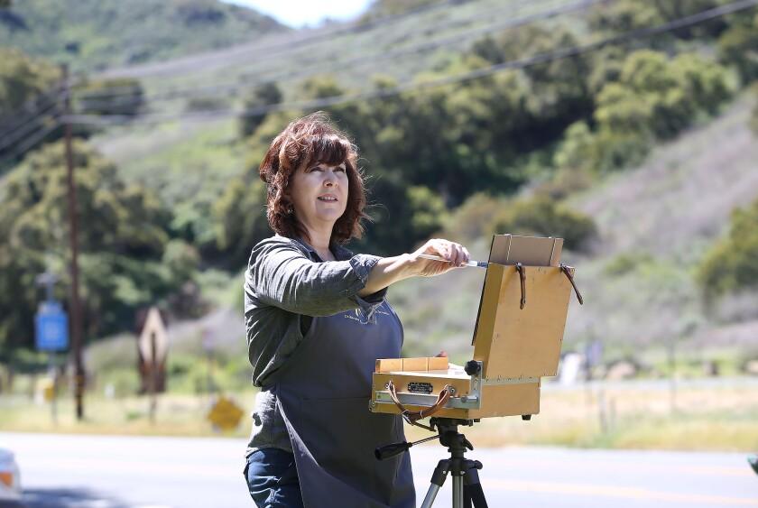 Plein air artist Wendy Wirth stays busy painting outdoor landscapes in and around Laguna Canyon in Laguna Beach.