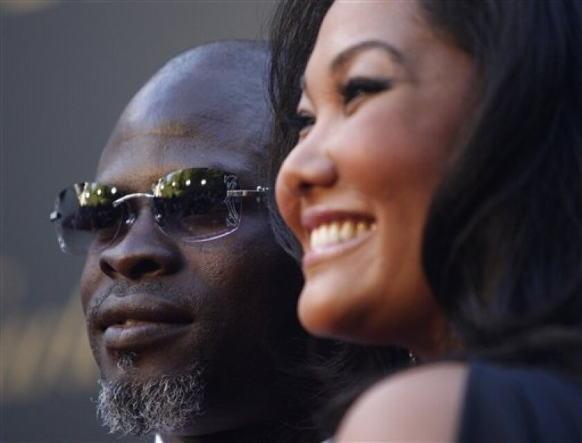 FILE - In this June 18, 2008 file photo, Djimon Hounsou, left, and Kimora Lee Simmons attend the third annual 2008 Cartier Loveday celebration in Los Angeles. (AP Photo/Matt Sayles, File)