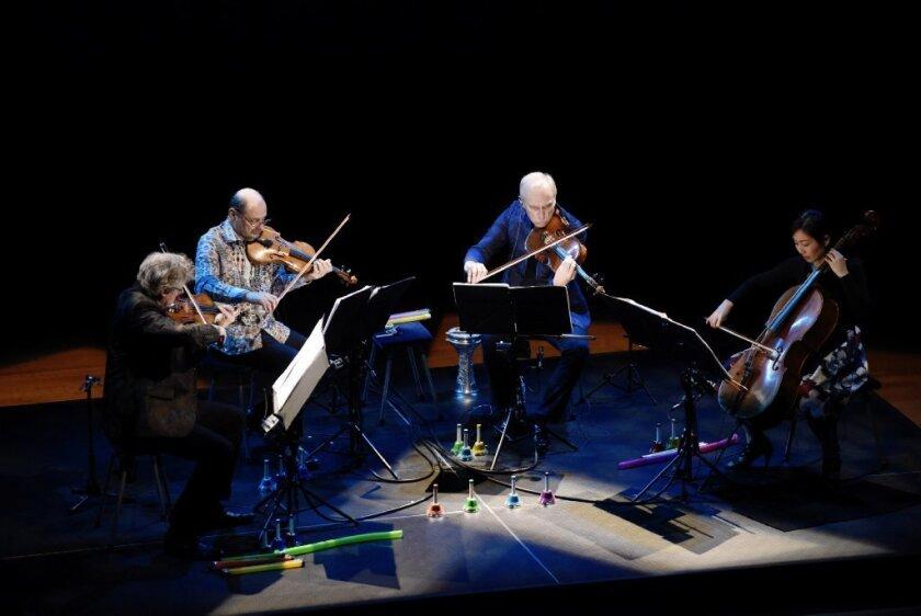 Kronos Quartet's David Harrington, left, John Sherba, Hank Dutt and Sunny Yang perform at the Musco Center for the Arts at Chapman University.