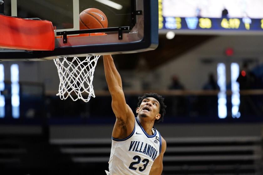 Villanova's Jermaine Samuels dunks the ball during the first half of an NCAA college basketball game against Georgetown, Sunday, Feb. 7, 2021, in Villanova, Pa. (AP Photo/Matt Slocum)