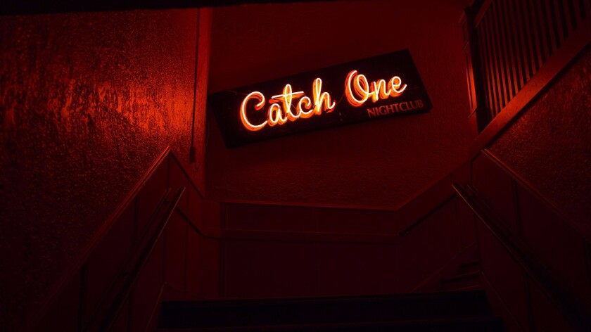 A neon sign that used to hang above the entrance to Jewel's Catch One.