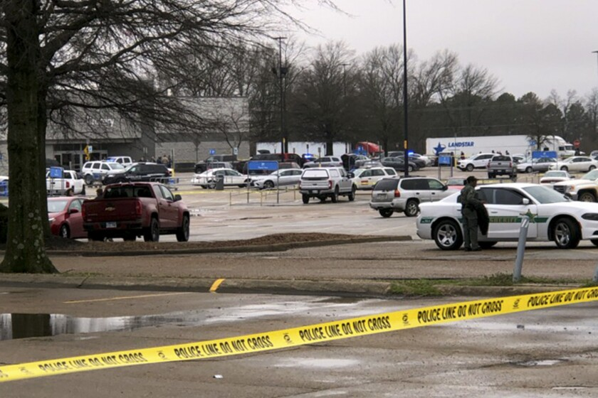 Law enforcement officials block off a Walmart store in Forrest City, Ark., on Monday, Feb. 10, 2020. Police say at least three people have been shot at the store. (Micaela A. Watts/The Commercial Appeal via AP)