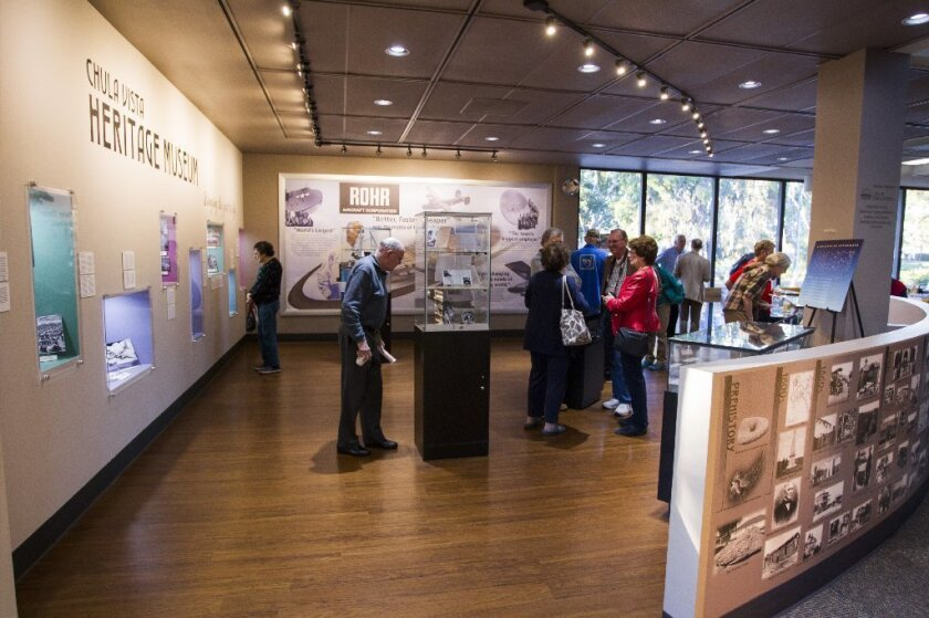 Attendees at the opening of a new exhibit on Rohr Aircraft Company at the Chula Vista Civic Center Library inside the Heritage Museum.