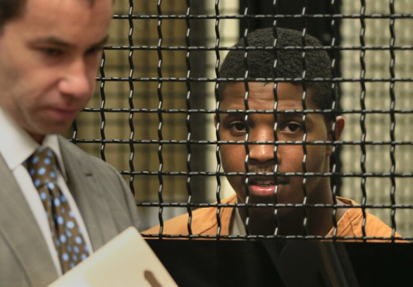 Christian Isaiah Barnes makes a brief court appearance in the North Justice Center in Fullerton with his attorney Seth Bank earlier this year.