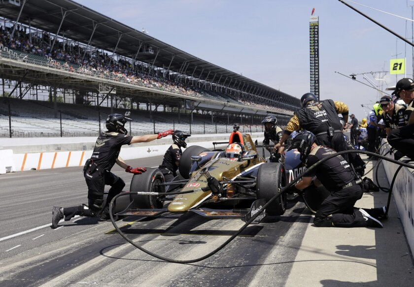 James Hinchcliffe, of Canada, practices a pit stop during the final practice session for the Indianapolis 500 auto race at Indianapolis Motor Speedway in Indianapolis, Friday, May 27, 2016. (AP Photo/Darron Cummings)