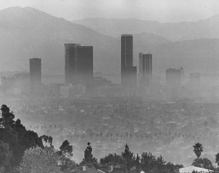 Downtown Los Angeles' tallest buildings rise above a blanket of smog in October 1973. (Fitzgerald Whitney / Los Angeles Times)
