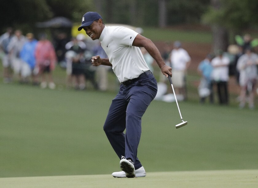 Tiger Woods reacts to his birdie putt on the 15th hole during the second round for the Masters golf tournament Friday, April 12, 2019, in Augusta, Ga.