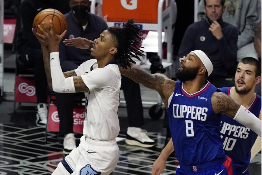 Memphis Grizzlies guard Ja Morant drives past Clippers forward Marcus Morris Sr.
