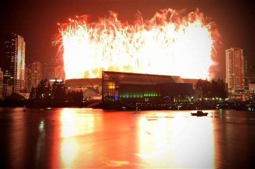 Fireworks are seen over the BC Place after the opening ceremony for the Vancouver 2010 Olympics in Vancouver, British Columbia, Friday, Feb. 12, 2010. (AP Photo/Bela Szandelszky)