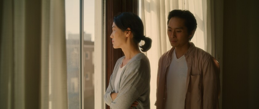 "Jackie Chung and Justin Chon in the movie ""Coming Home Again."""
