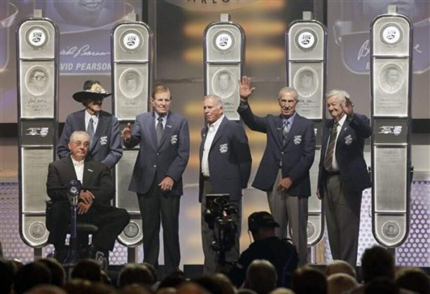 This year's NASCAR Hall of Fame inductees, from right, Bobby Allison, Ned Jarrett, David Pearson, Bud Moore, Richard Petty and Maurice Petty, pose during a ceremony in Charlotte, N.C., Monday, May 23, 2011. The Pettys were representing their father, Lee Petty. (AP Photo/Terry Renna)