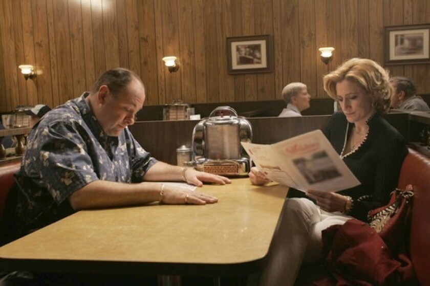 """James Gandolfini and Edie Falco, as Tony and Carmela Soprano, sitting across from each other in a restaurant booth in """"The Sopranos."""""""