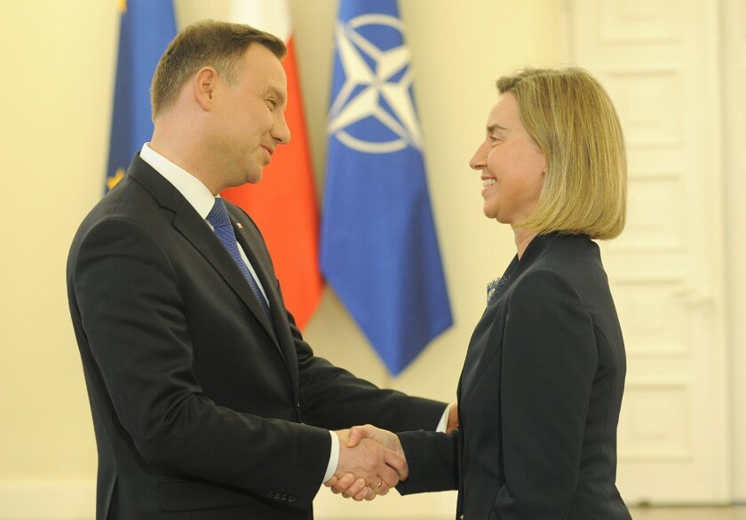 Polish President Andrzej Duda, left, meets EU Foreign Affairs chief Federica Mogherini, in Warsaw, Poland, Thursday, June 2, 2016. (AP Photo/Alik Keplicz)