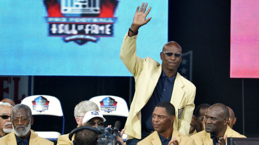 Hall of Fame enshrinee Eric Dickerson is introduced during the Pro Football Hall of Fame enshrinement ceremony, in Canton, Ohio on Aug 2, 2014.
