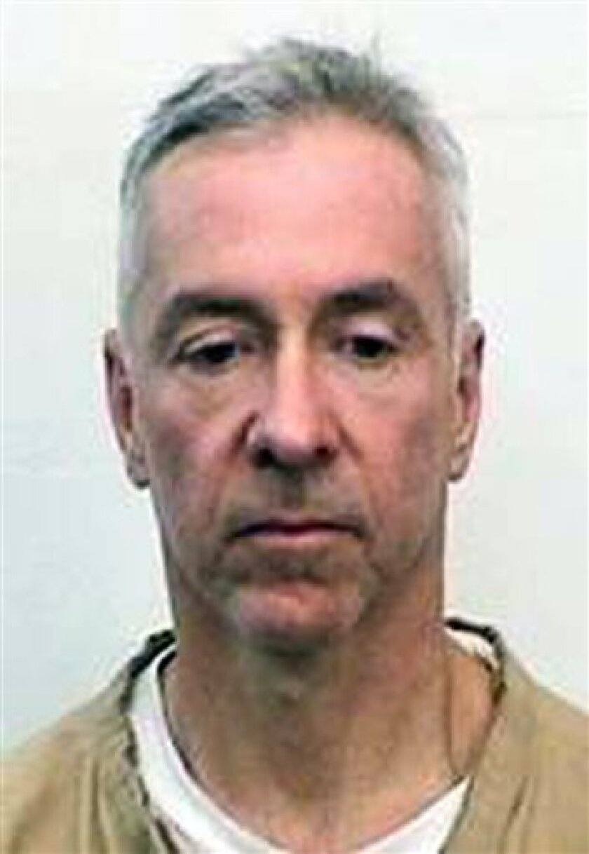In this undated photo provided by the Indiana State Prison, Mark Booher is shown in a booking photo. Booher, 46, who was convicted of murder, is believed to be among the three convicts who were discovered missing from the Indiana State Prison on Sunday July 12, 2009. (AP Photo/Indiana State Prison)
