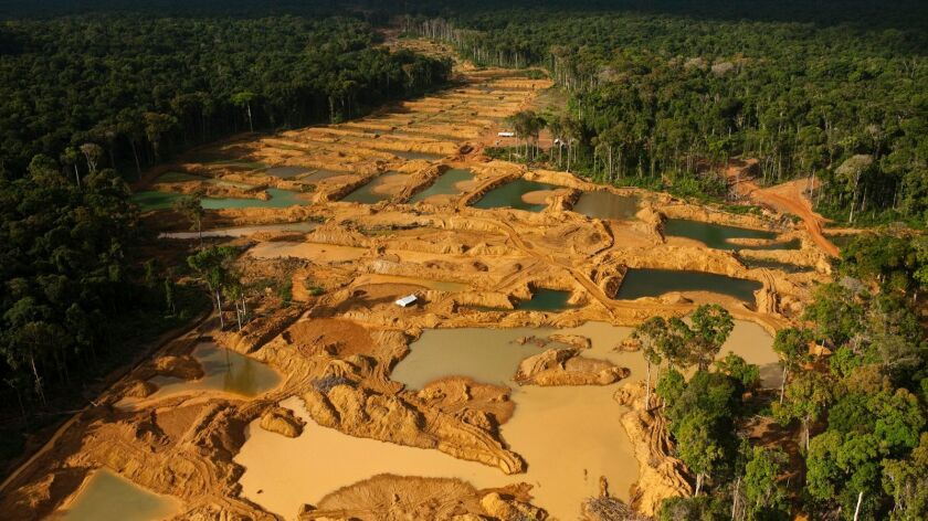This photo from 2009 shows the effect of alluvial gold mining in a rain forest in Guyana, South Amer