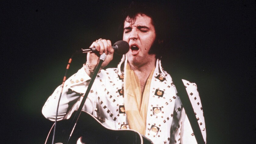 Elvis Presley performs during a 1973 concert.
